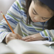 Young girl doing her homework — Stock Photo #13226166