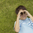 Young boy looking through toy binoculars — Stock Photo