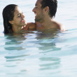 South American couple smiling at each other in water — Stock Photo