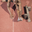 High angle view of man stretching on track — Stock Photo #13226228