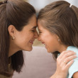 Profile of mother and daughter touching noses — 图库照片