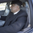 Close up of chauffeur driving car — Stock Photo