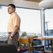 Stock Photo: Man at home standing near window