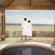 Stock Photo: Couple in bathrobes outdoors at beach resort