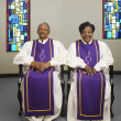 Senior African couple wearing church choir gowns — Stock Photo