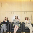 Stock Photo: Three businesswomen clapping