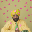 Portrait of businessman wearing turban with sticky notes attached everywhere — Stock Photo