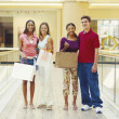 Teen friends pose in aisle of shopping mall — Stock Photo