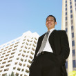 Stock Photo: Low angle view of Hispanic businessman