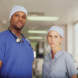 Male and female surgeons posing — Stock Photo
