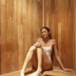 Woman sitting in sauna — Stock Photo