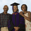 Stock Photo: Female graduate with parents