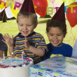 Group of boys at birthday party with cake — Stock Photo