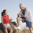 Senior couple resting during a workout — Foto Stock