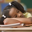 Student sleeping at her desk — Stock Photo