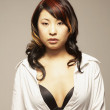 Royalty-Free Stock Photo: Asian woman with shirt unbuttoned