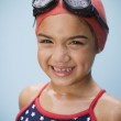 Stock Photo: Hispanic girl in bathing suit with goggles and swim cap