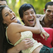 Stock Photo: South Americfriends laughing