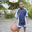 Stock Photo: Young boy dribbling basketball
