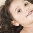 Close up portrait of little girl smiling - Stock Photo