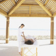 Woman getting massage outdoors at health spa  — Stock Photo