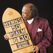 Stock Photo: Senior Africmholding hymn board