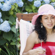 Young woman relaxing in a lawn chair — Stock Photo #13227142