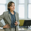 Hispanic businesswoman pointing — Stock Photo