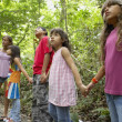 Stock Photo: Hispanic children exploring woods