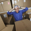 Frustrated businessman in warehouse — Stock Photo