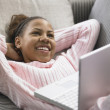 Teenage girl using a laptop — Stockfoto