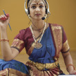 Stock Photo: Indian woman in traditional dress using a headset