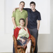Portrait of Hispanic mother and adult sons — Stock Photo #13227296