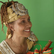 Woman with wrapped gift - Stock Photo