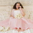 Stock Photo: Hispanic girl on cell phone in Quinceanera dress