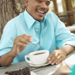Stock Photo: Mdrinking coffee and laughing
