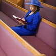 Senior African American woman in church — Stock Photo