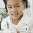 African girl holding piggy bank — Stock Photo