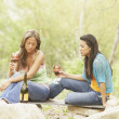 Two young women holding glasses of wine — Stock Photo #13227445