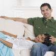 Portrait of Hispanic couple on sofa — Stock Photo