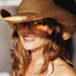 Young woman in hat and sunglasses — Foto Stock