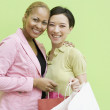 Mixed Race women holding shopping bags — Stock Photo