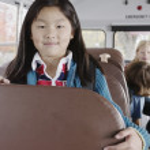 Portrait of girl on school bus — Stock Photo