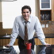 Hispanic businessman in kitchen — Stock Photo