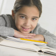 Stock Photo: Young girl doing her homework