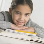 Young girl doing her homework — Stock Photo