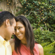 Hispanic couple smiling at each other outdoors — Stock Photo