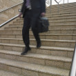 Stock Photo: Blurred view of businessman's legs descending stairs
