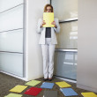 Businesswoman backed into corner by file folders — Stock Photo