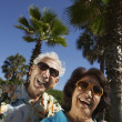 Senior Hispanic couple laughing outdoors — Stock Photo
